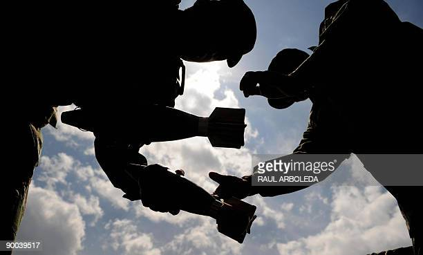 Colombian soldiers handle morter grenades on August 24 2009 in Medellin Antioquia department The Colombian army and the Department of Administrative...