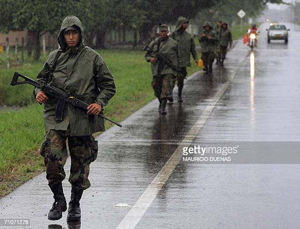 Colombian soldiers patrol a highway during presidential elections, 28 May, 2006 in Pompeya, department of Meta, Colombia. A total of 26.7 million...