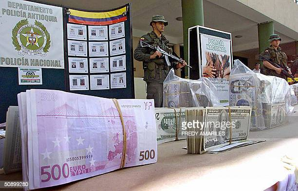 Colombian soldiers show to the press part of the Colombian Pesos 1182467875 made up by US Dolars Euros Colombian Pesos and Yens from the drug...