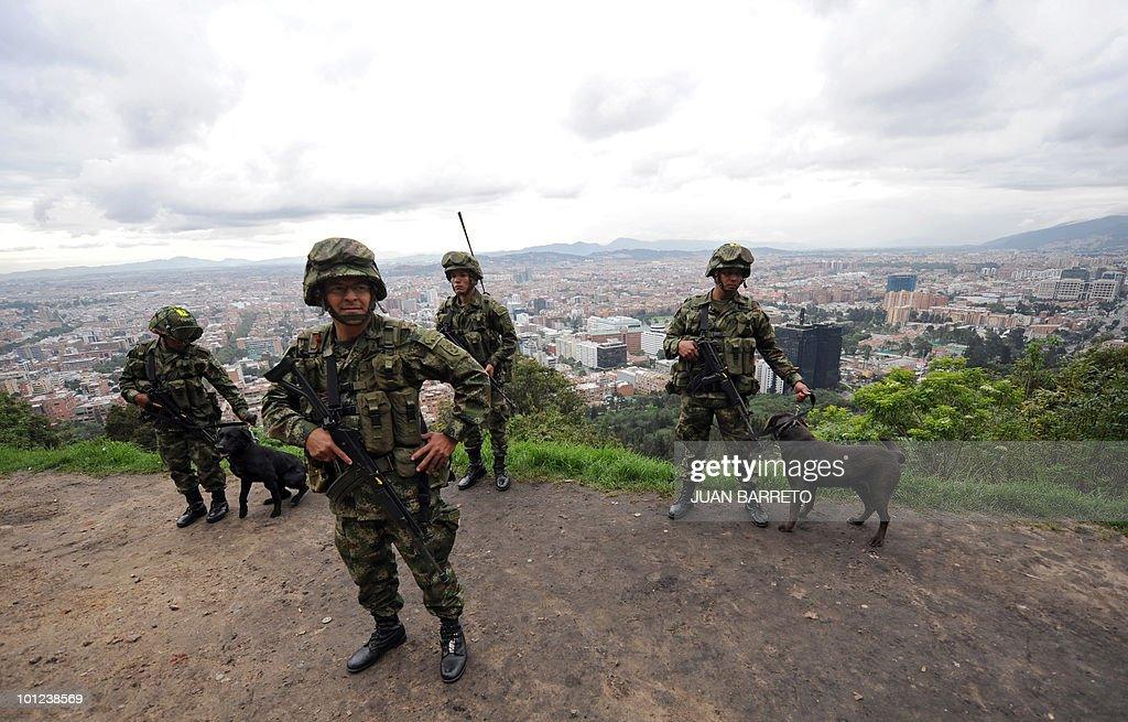Colombian soldiers stand guard in a checkpoint in Bogota, on May 28, 2010. Colombia will hold presidential elections next May 30.