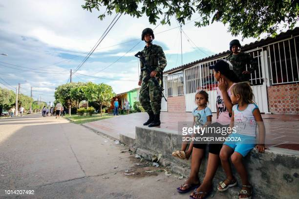 Colombian soldiers stand guard on a street in Tibu Norte de Santander department Colombia during the visit of Colombian President Ivan Duque on...