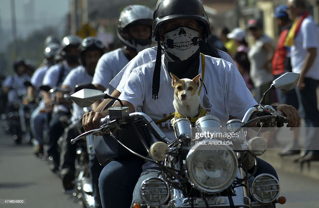 Colombian soldiers victims of landmines and motorcyclists take part in the Fallen Heroes motorcade, carried out in silence to remember the soldiers and policemen killed in combat, on May 24, 2015, in Medellin, Antioquia department, Colombia. . AFP PHOTO/Raul ARBOLEDA