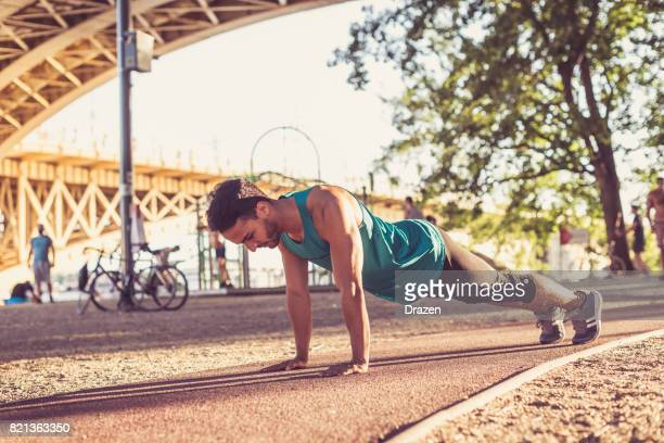 colombian sportsman doing push ups - circuit training stock photos and pictures