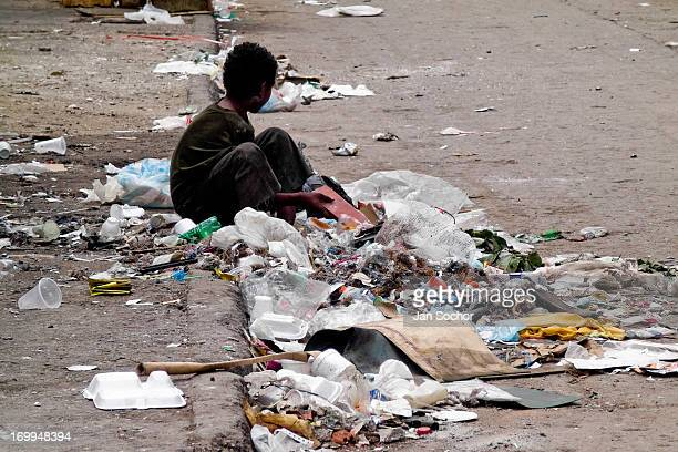 Colombian street kid recollects garbage in the slum of Calvario on 4 April 2004 in Cali Colombia Calvario a slum right in the centre of the city is...