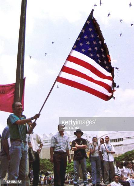 Colombian students burn a North American flag in the city of Cali, Colombia, 30 August 2000, to protest the visit of US President, Bill Clinton....