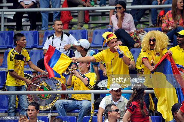 Colombian supporters cheer for their team during the Davis Cup World Group Playoff singles match between Santiago Giraldo of Colombia and Taro Daniel...