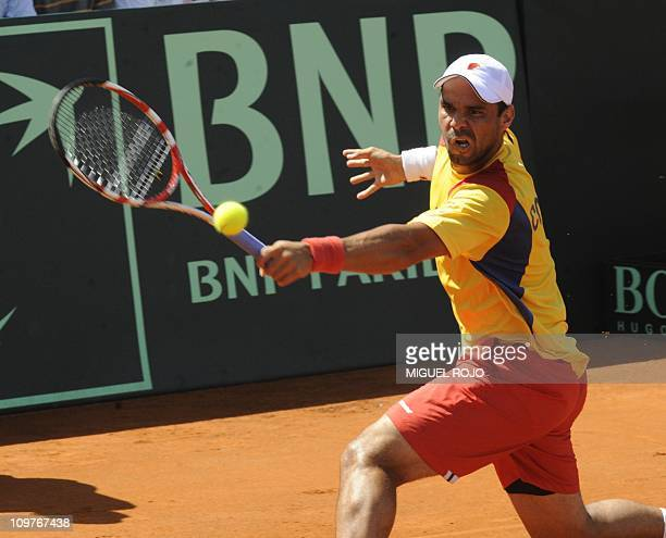 Colombian tennis player Alejandro Falla returns the ball to Uruguay's Pablo Cuevas during their Davis Cup American Zone Group 1 match in Montevideo...