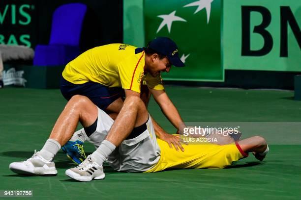 Colombian tennis player Alejandro Gonzalez celebrates with his teammate Pablo Gonzalez after defeating Brazilian tennis player Joao Sorgi during...