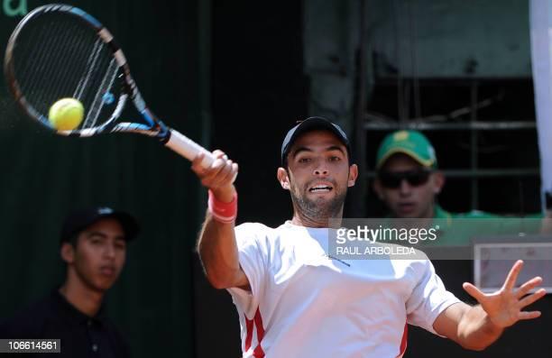 Colombian tennis player Juan Sebastian Cabal returns the ball to Marcos Daniel of Brazil during their final match of the Open Challenger Series...