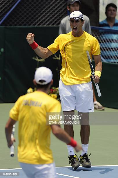 Colombian tennis player Robert Farah celebrates after winning a point against Uruguay during their Davis Cup Americas Group I second round doubles...