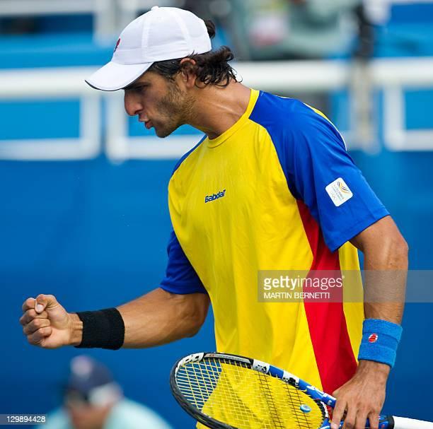 Colombian tennis player Roberto Farah celebrates his win over Dominican Victor Estrella in their XVI Pan American Games man singles game in...