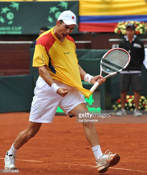 Colombian tennis player Santiago Giraldo celebrates a victory over Sam Querrey of US after a tennis match as part of Davis Cup World Group Playoffs...