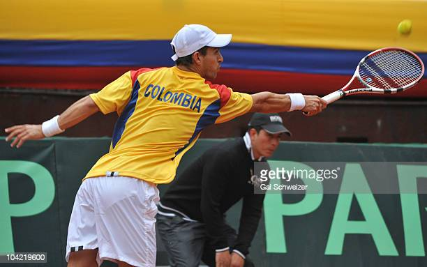 Colombian tennis player Santiago Giraldo in action against Sam Querrey of US during a tennis match as part of Davis Cup World Group Playoffs at La...