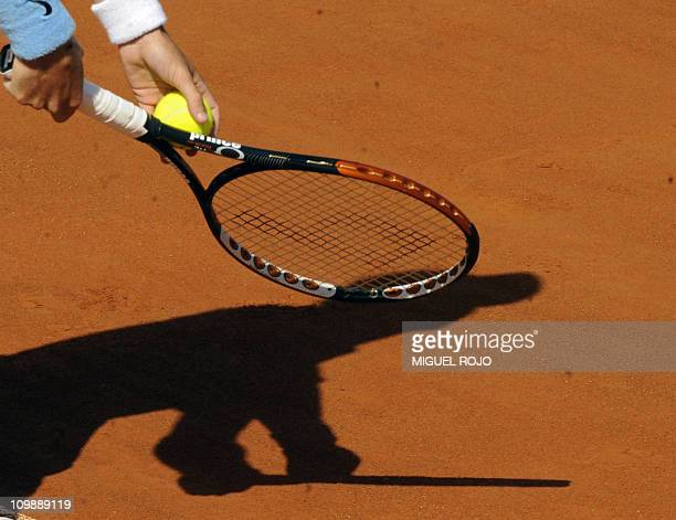 Colombian tennis player Santiago Giraldo prepares to serve during a singles Davis tennis match against Uruguayan Pablo Cuevas on March 6, 2011....