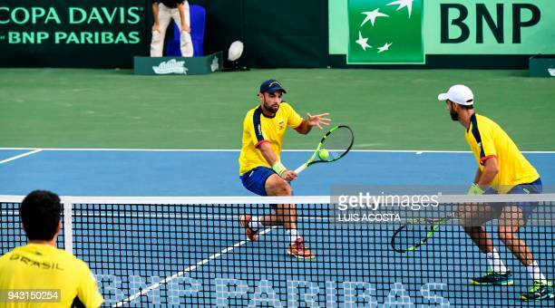 Colombian tennis players Juan Sebastian Cabal and Robert Farah return the ball to Brazilian tennis player Marcelo Melo and Marcelo Demoliner during...