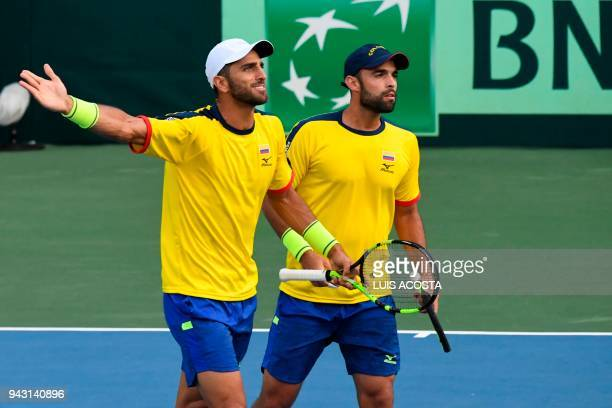 Colombian tennis players Robert Farah and Juan Sebastian Cabal argue with the judge during their Americas Zone Group I 2nd round Davis Cup tennis...