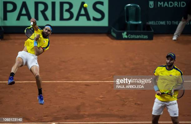 Colombian tennis players Robert Farah and Juan Sebastian Cabal return a ball to Sweden players Markus Eriksson and Robert Lindstedt during their...