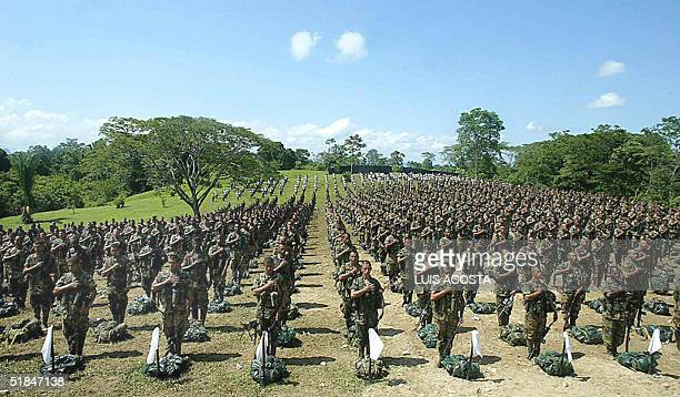 Colombian United Self Defense right-wing paramilitary guerrillas fall in ranks during the demobilization ceremony 10 December, 2004 at Camp Two base...
