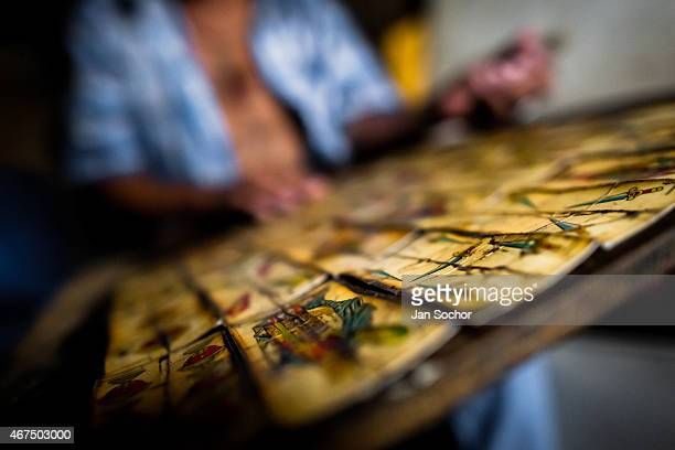 Colombian urban shaman plays the cards in orther to predict the future at his house on April 17 2013 in Cali Colombia Although the original spiritual...