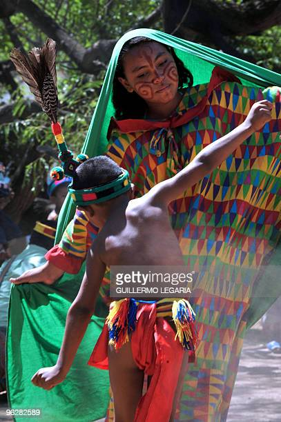 Colombian Wayuu indigenous children dance during a meeting between the army and villagers of the town of Uribia in La Guajira Department close to the...
