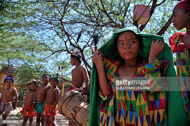 Colombian Wayuu indigenous children prepare to perform during a meeting between the army and villagers of the town of Uribia in La Guajira Department...