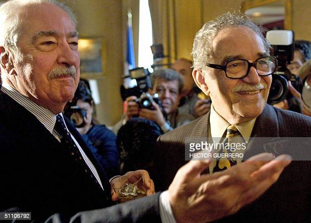 Colombian writer Alvaro Mutis and fellow countryman and colleague Gabriel Garcia Marquez greet journalists at the French Embassy in Mexico City 22...