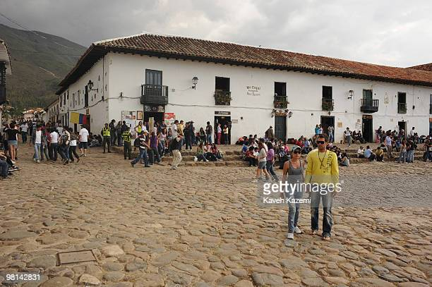 Colombian youth drink play music and get high on drugs in Plaza Mayor during 'Light Festival' Villa de Leyva is a colonial town and municipality in...
