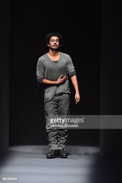 Colombianborn Belgiantrained designer Haider Ackermann acknowledges the public at the end of his autumn/winter 2009 readytowear collection show in...