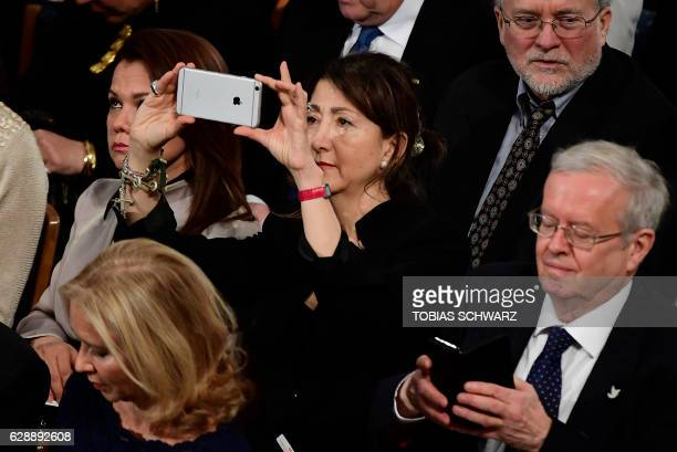Colombian-French politician and anti-corruption activist Ingrid Betancourt takes pictures with her mobile device as she waits for the beginning of...