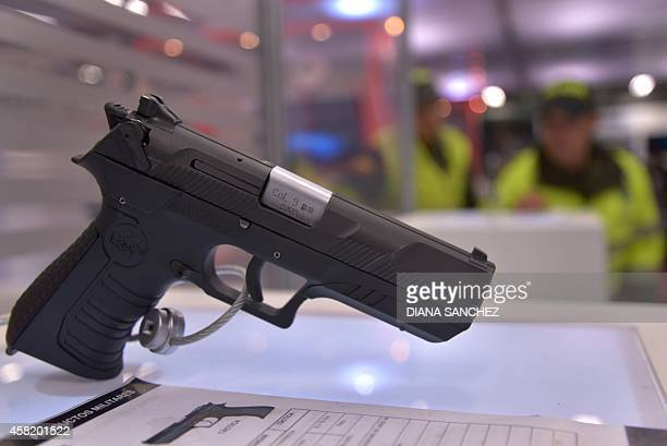 A Colombianmade Cordova 9mm pistol on display during the International Defense and SecurityTrade Fair at the Corferias Exhibition Center in Bogota on...