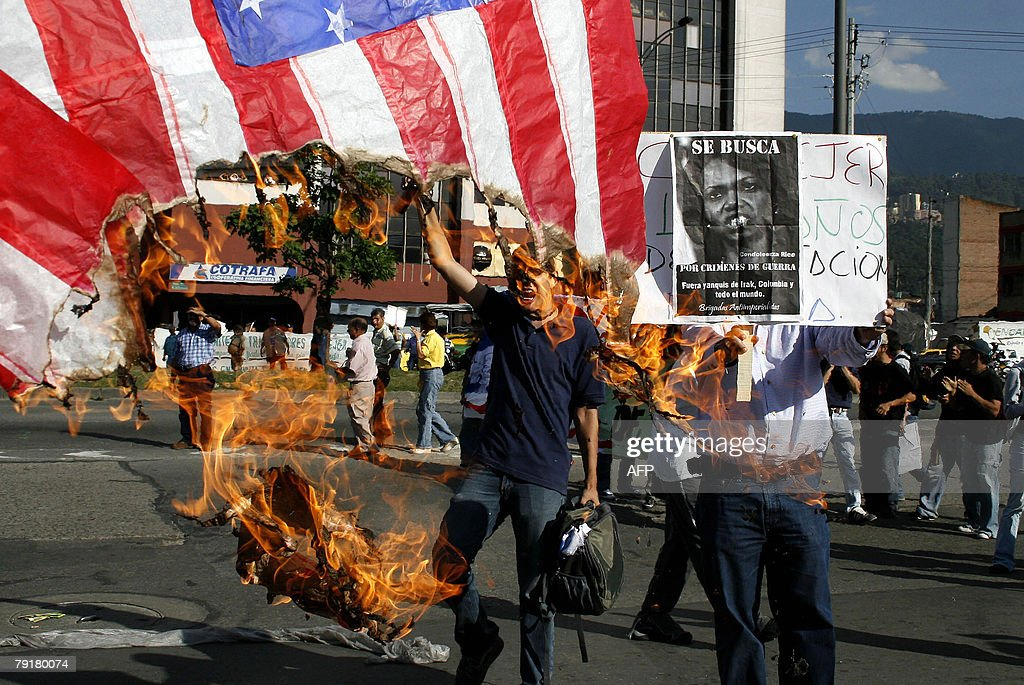 Colombians burn a US national flag during a demonstration against the visit of US Secretary of State Condoleezza Rice 23 January 2008 in Medellin, Antioquia department, Colombia. Rice will arrive to Colombia Thursday for a 24-hour official visit. AFP PHOTO/Raul ARBOLEDA