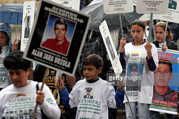 Colombians hold signs with pictures of those kidnapped by the Revolutionary Armend Forces of Colombia during a demonstration demanding their release...