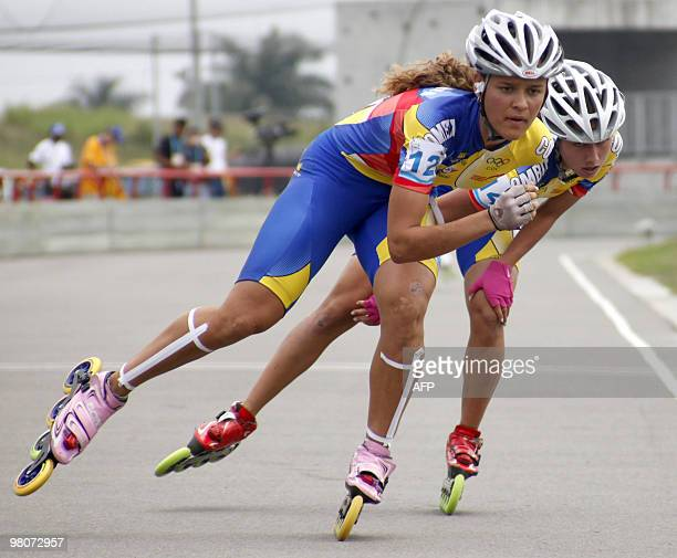 Colombians Kelly Martinez and Martha Ramirez compete in women's 10000m points during the IX South American Games in Medellin Antioquia department...