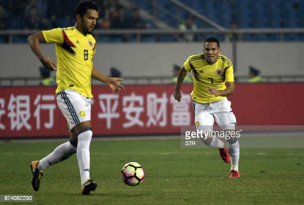 Colombia's Abel Aguilar runs with the ball next to teammate Carlos Bacca during their international friendly football match against China in...