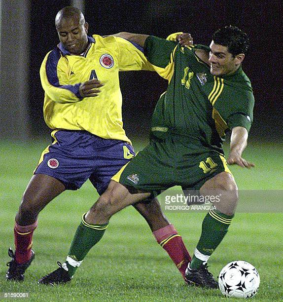 Colombia's Alexander Viveros fights for the ball with Australia's John Aloisi 28 February during a friendly match in Bogota Colombia won 31 AFP...
