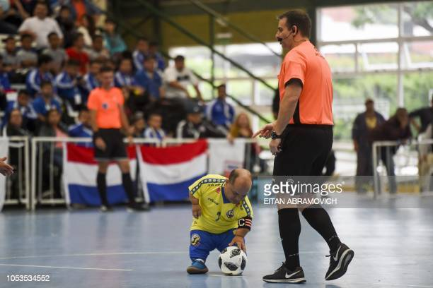 Colombia's Alexis Calvo places the ball to kickoff during a Dwarf Copa America Talla Baja football match against Argentina at Ferro Carril Oeste Club...