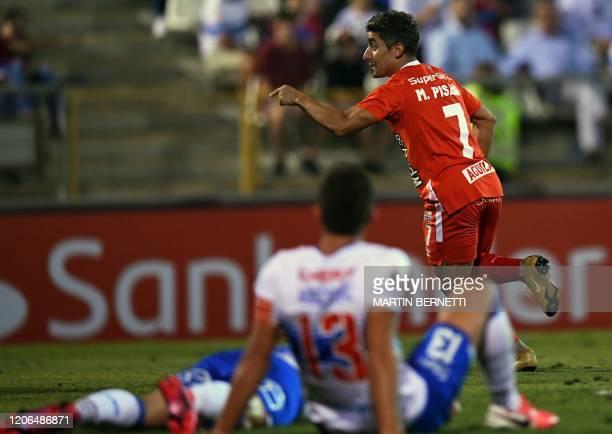 Colombia's America de Cali midfielder Matias Pisano celebrates his goal against Chile's Universidad Catolica during their Copa Libertadores football...