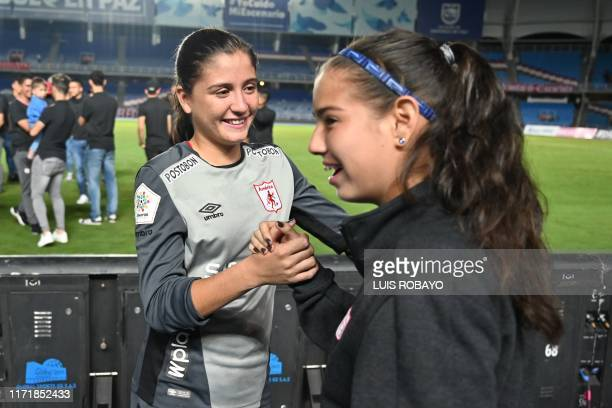 Colombia's America de Cali Natalia Giraldo shakes hand with teammate Isabella Ceron at the end of the Colombian women's football league first leg...