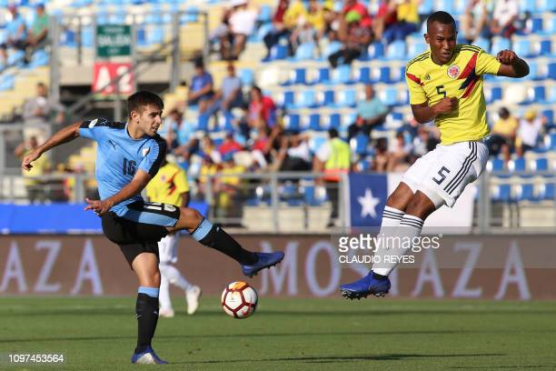Colombia's Andres Balanta vies for the ball with Uruguay's Nicolas Acevedo during their South American U20 football match at El Teniente stadium in...