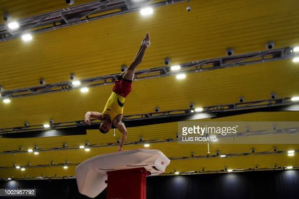 Colombia's Andres Martinez competes on the Vault in the Artistic Gymnastics men's team final event during the 2018 Central American and Caribbean...