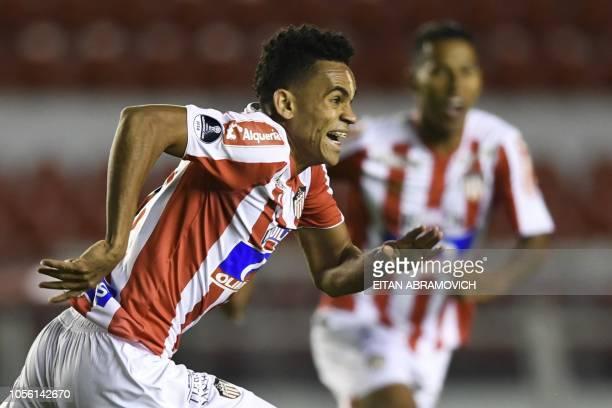 Colombia's Atletico Junior forward Luis Diaz celebrates after scoring against Argentina's Defensa y Justicia during their Copa Sudamericana...
