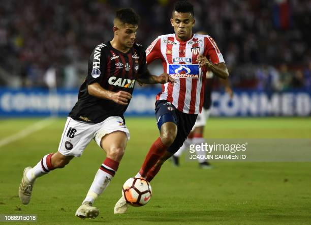 Colombia's Atletico Junior Luis Diaz views for the ball with Brazil's Atletico Paranaense Bruno Guimaraes during their Copa Sudamericana first leg...