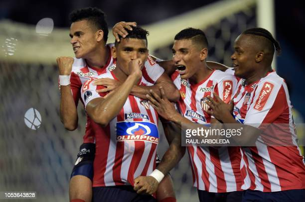 TOPSHOT Colombia's Atletico Junior player Rafael Perez celebrates with teammates after scoring against Argentina's Defensa y Justicia during a Copa...