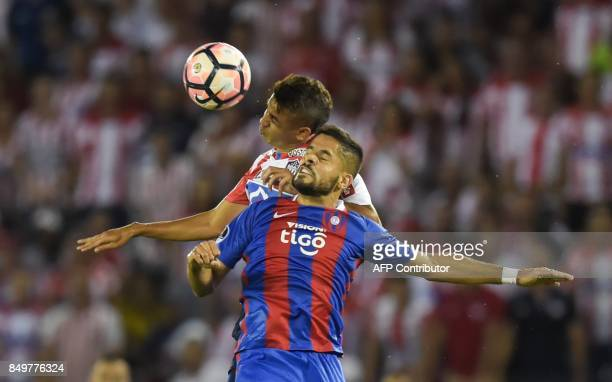 Colombia's Atletico Junior player Victor Cantillo vies for the ball with Paraguay's Cerro Porteno Juan Aguilar during their Copa Sudamericana...