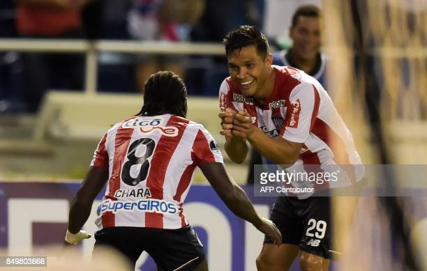 Colombia's Atletico Junior player Yimmi Chara celebrates with teammates after scoring against Paraguay's Cerro Porteno during their Copa Sudamericana...