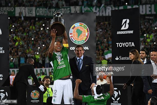 Colombia's Atletico Nacional Alexis Henriquez holds up the trophy after winning the 2016 Copa Libertadores at Atanasio Girardot stadium in Medellin...
