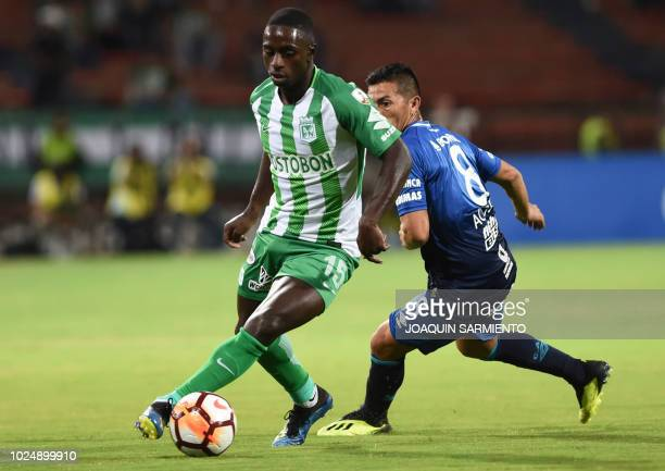 Colombia's Atletico Nacional Deiver Machado vies for the ball with Argentina's Atletico Tucuman player Guillermo Acosta during their Copa...