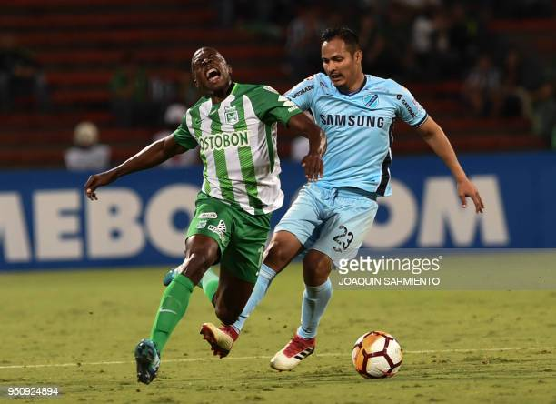 Colombia's Atletico Nacional Helibelton Palacios vies for the ball with Bolivia's Bolivar Leonel Justinlago during their Copa Libertadores football...