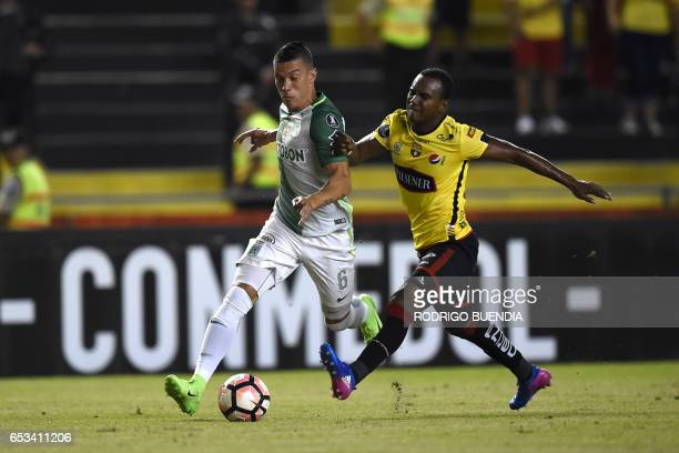 Colombia's Atletico Nacional Mateus Uribe vies for the ball with Ecuador's Barcelona Pedro Velasco during their Copa Libertadores football match at...