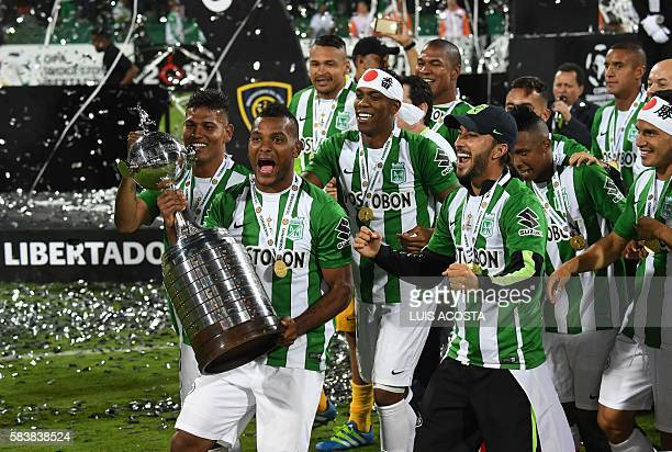 Colombia's Atletico Nacional Miguel Borja celebrates with the trophy after winning the 2016 Copa Libertadores at Atanasio Girardot stadium in...